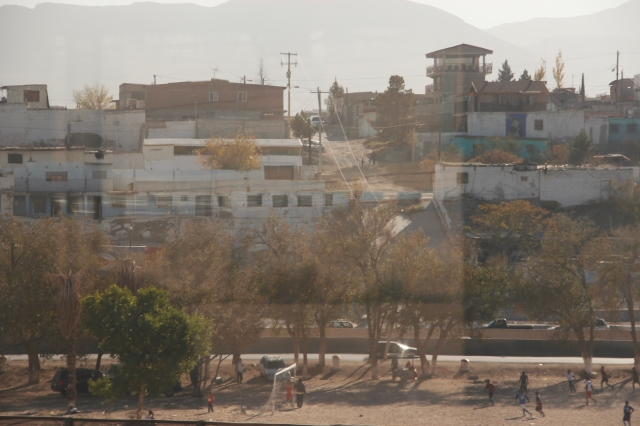 Kids playing soccer in Juarez, Mexico