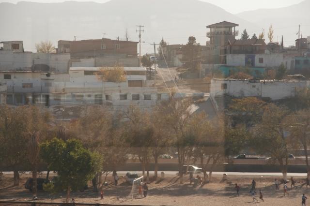 Kids playing soccer in Juarez, Mexico